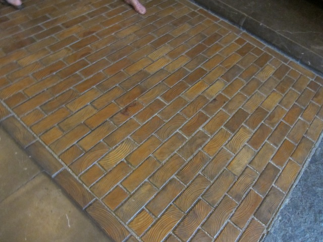 Carriage entry floor made to look like brick, but it's wooden to muffle sound