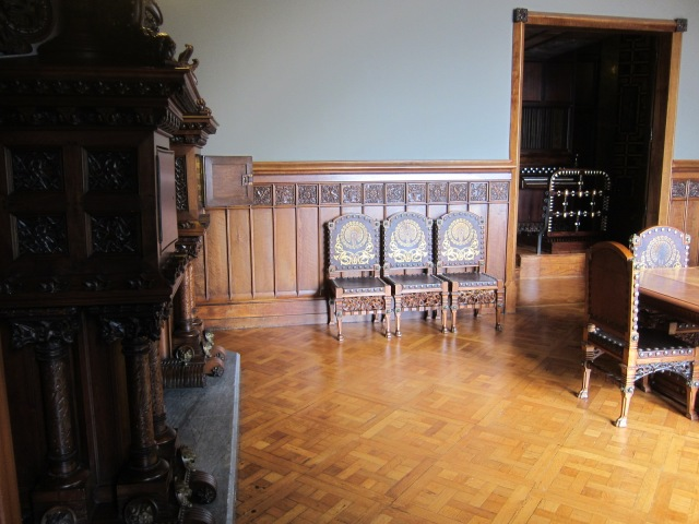 Ornate organ to right, just off of dining room