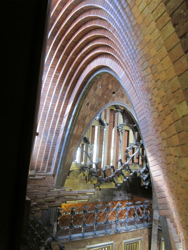 Peek-a-boo view from attic; pipes from organ at left; note catenary arches