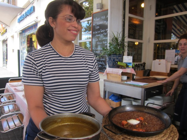 Our friendly waitress, Adelina, who didn't want her picture taken, had a friend show us our dishes before cooking, but got caught in this photo (right).  Sorry, Adelina!
