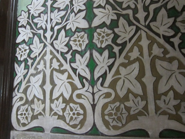 Carved and painted stucco lobby walls